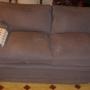 sofá de plumón gris