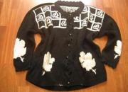 Chaqueta artesanal negra usada