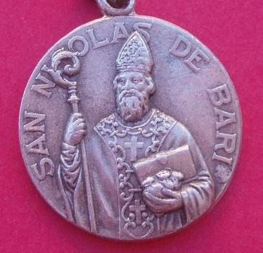 Medallas san nicolas de bari en oro y en plata.