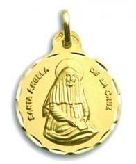 Medallas sor angela de la cruz en oro y en plata.