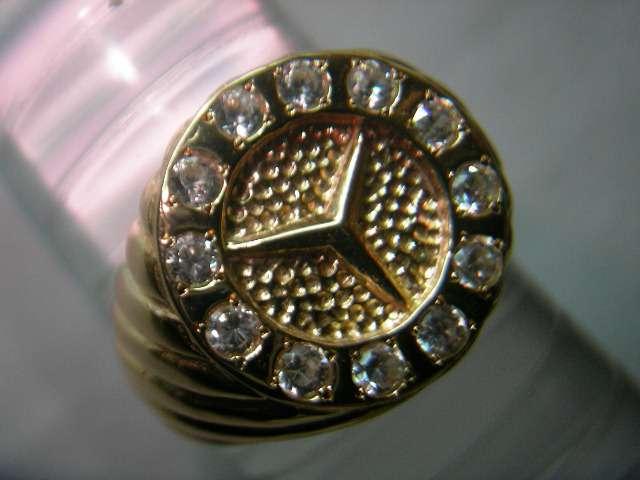 Sello-mercedes en oro y plata