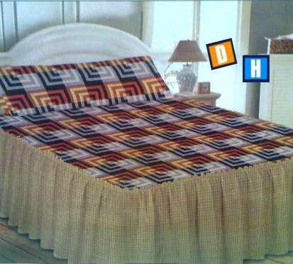Fotos de Colchas con volante para cubrir la cama 5