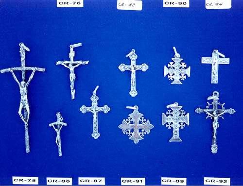 Cruces-cristos en oro y plata