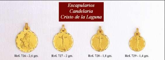 Medalla virgen de la candelaria en oro y en plata.